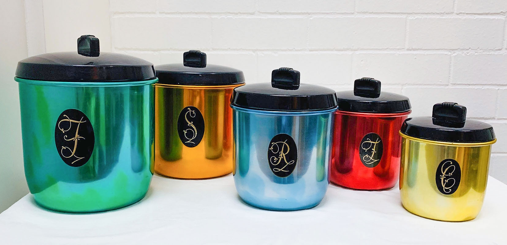 Anodised canisters. Manufacturers including Raeco, Colorware, Kartell, Model Maid. Canister sets, bakelite, aluminium, sugar bowls, teapots, stacking travel cups, kitchenware, pudding bowl, kettle, soda syphon, ice buckets and fondue sets