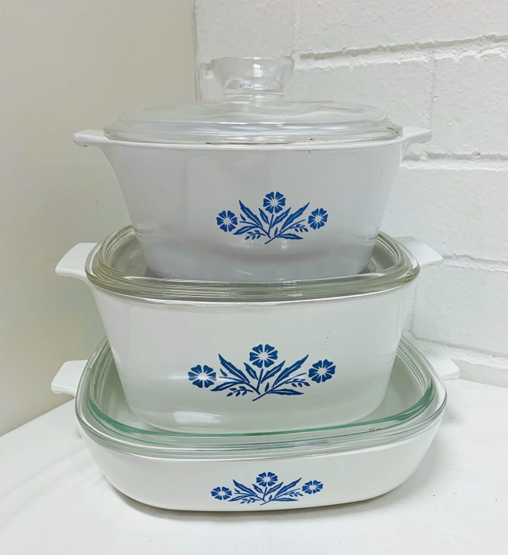 "Corningware casserole set in cornflower blue pattern. Other pieces include teapots, coffee pots, other patterns, white and clear glass, ""spice of life"" pattern too."